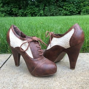 brown and cream heeled lace up bootie